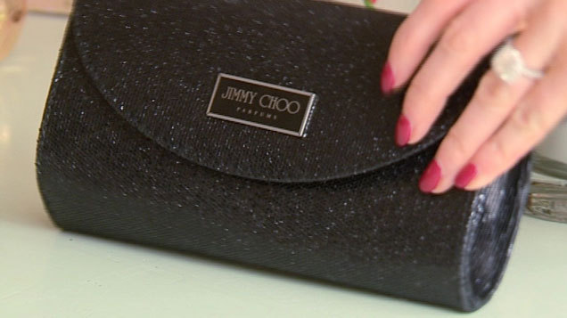 3b31c40379 If you can't afford a Jimmy Choo bag from their stores this is a very nice  enter level clutch plus you get a bottle of perfume too.