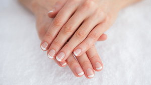 French manicured fingers at spa center