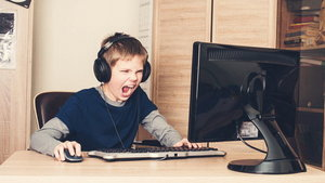 Gaming, entertainment, technology, let's play concept. Angry screaming pre teen