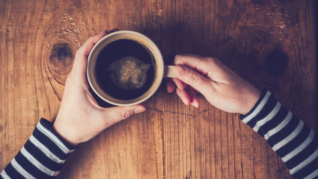Lonely woman drinking coffee in the morning (Thinkstock/PA)