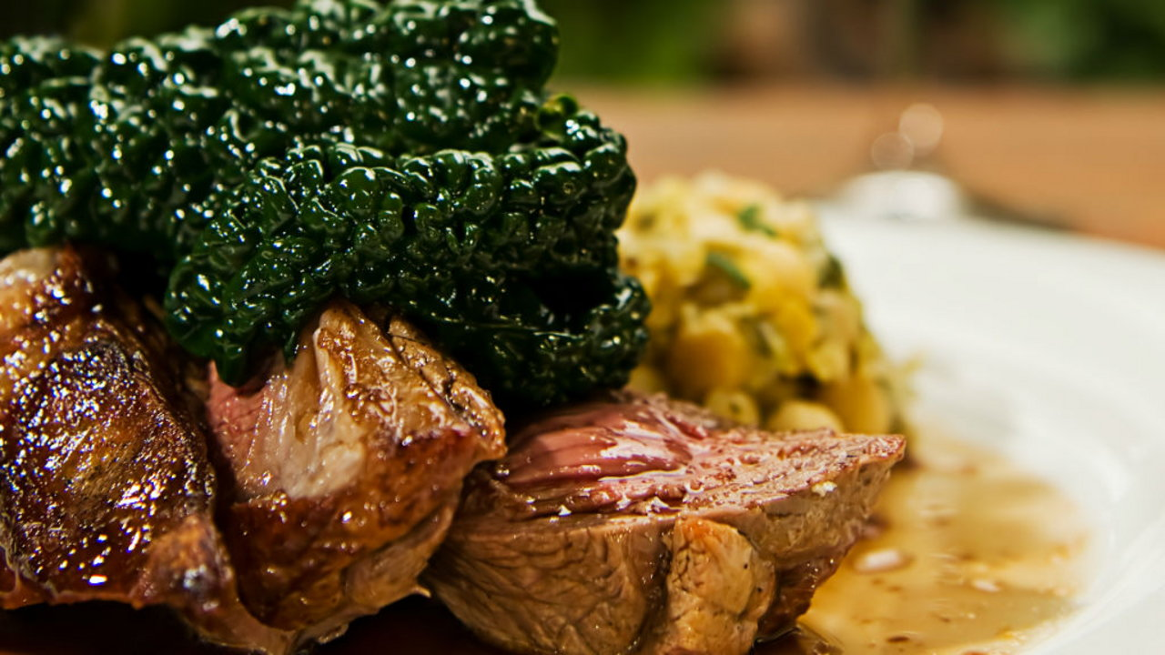 Joes Irish lamb rump with minted champ, braised red cabbage and redcurrant jus