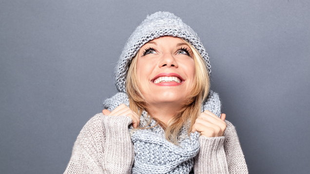 dreaming young blond woman with winter hat and imagination