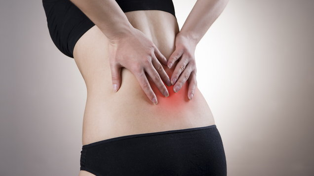 Woman with back pain highlighted in red as dramatic effect