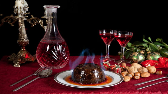Christmas dinner table with pudding and decanter