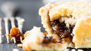 Traditional British Christmas Pastry Dessert Home Baked Mince Pie with Apple Raisins Nuts Filling. Open with Visible Texture. Golden Shortcrust Fork. Festive Table Setting