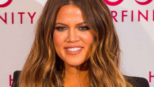 Khloe Kardashian Displays Baby Bump While Working out With Sister Kourtney