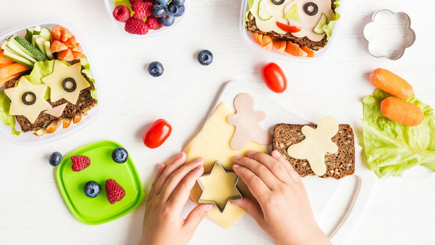 School lunch box for kids. Cooking. Child's hands. Flat lay