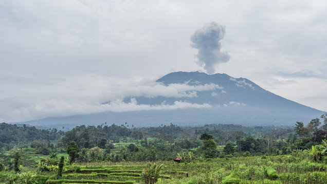 Agung volcano eruption view near rice fields, Bali, Indonesia