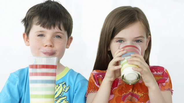Boy and Girl Drinking Milk Shakes