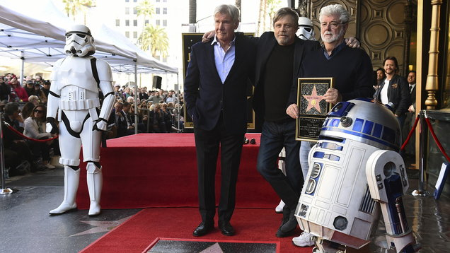 Mark Hamill with fellow Star Wars cast member Harrison Ford and creator George Lucas