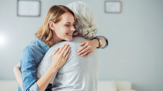 Positive woman embracing with her mother
