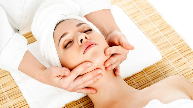Woman getting face massage during spa
