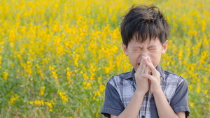 boy has allergies from flower pollen