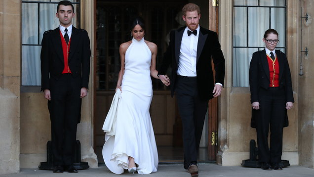 How did Meghan's evening reception gown compare to Kate's?