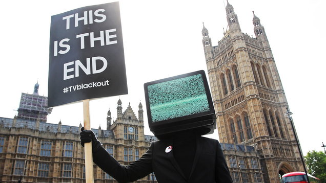 'TV heads' with signs calling for the end of blank TV screens to promote a new advertising campaign (Joe Pepler/PinPep)