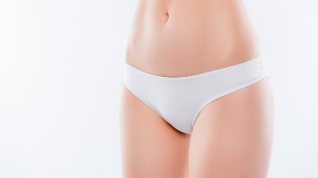 Guts hairless smooth fresh pure flawless soft after shaving treatment skinny indigestion trouble maternity concept. Cropped close up photo of thin slender woman's hips isolated on background