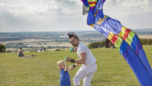 Visitors flying a kite at the 2014 Dunstable Kite Festival, on the Dunstable Downs, Bedfordshire.