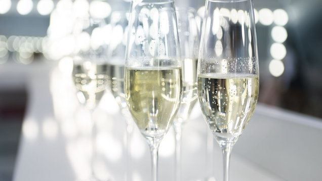 Champagne glasses on white background in bright lights