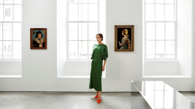 Victoria Beckham with some of the Old Masters paintings (Sotheby's/PA)