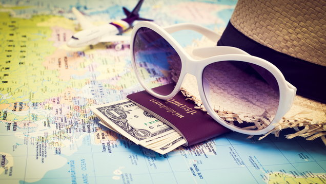 Sunglasses, Passport, Money, Hat and aircraft on the world map