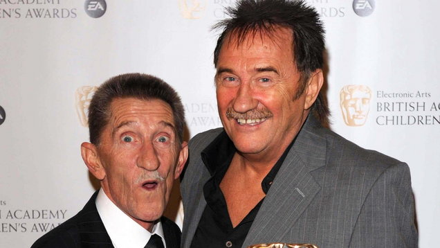 The Chuckle Brothers, Barry and Paul, hold BAFTA awards