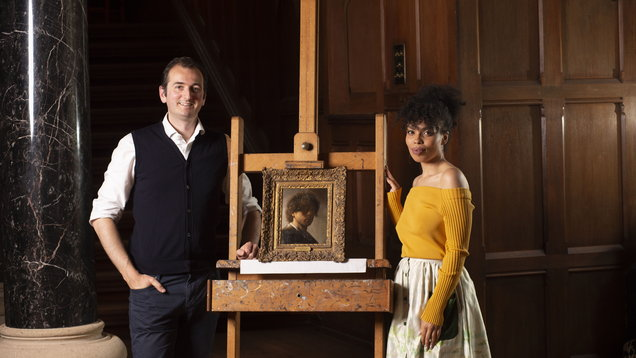 Dr Bendor Grosvenor and co-presenter Emma Dabiri with the Rembrandt portrait
