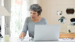Senior woman checking bills