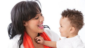 Real People: Black African American Mother Talking with Toddler
