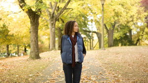 Young woman walking in park, portrait