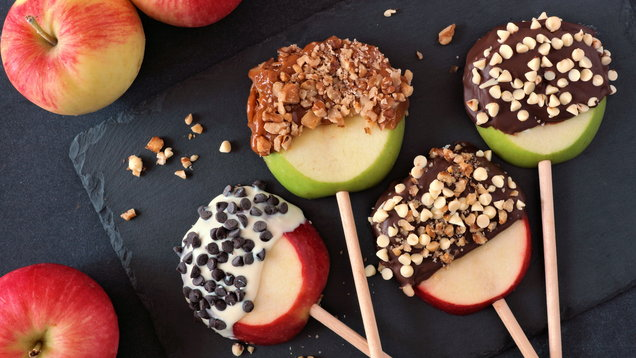 Candy dipped apples rounds, above on slate
