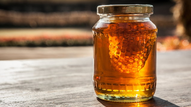 Honeycomb in honey Jar on the table