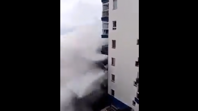 Enormous wave rips through apartment, wipes out third-storey balconies