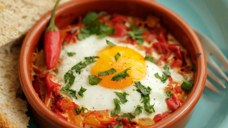 Spanish baked eggs with Don Carlos olives and harissa