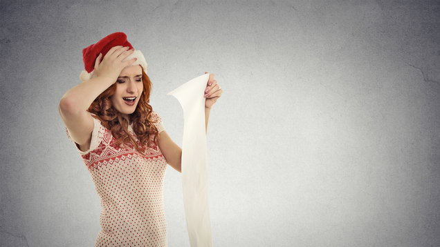 Christmas woman with red Santa Claus hat screaming holding long wish list stressed out showing frustration.