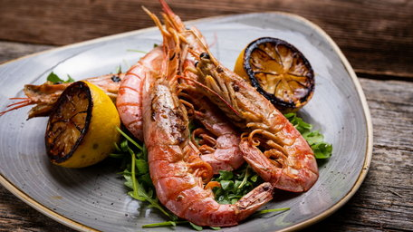 Chermoula king prawns, lime yoghurt with blood orange, fennel, rocket salad