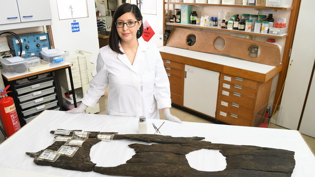 Conservator Luisa Duarte works on a 12th Century triple toilet seat