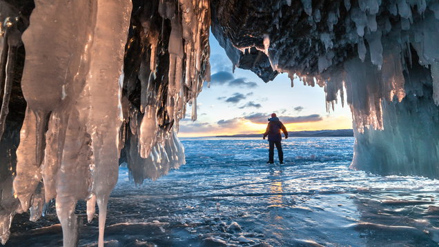 Hiker at the ice cave and across sunrise.