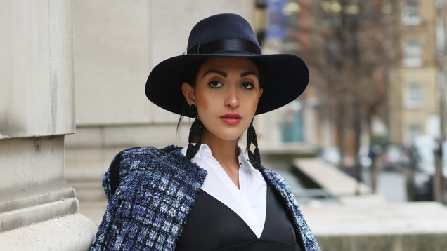 Fashionista Martina Gurgel wears Chanel and Topshop during the Autumn/Winter 2019 London Fashion Week outside Freemasons' Hall, London.