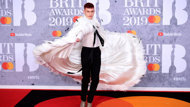 In honour of his Brits feathered white cape, 6 times Olly Alexander has been our style icon