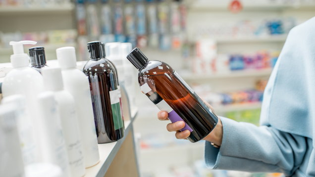 Taking a bottle with cosmetics in te pharmacy