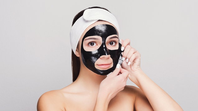 Young girl with purifying black face mask