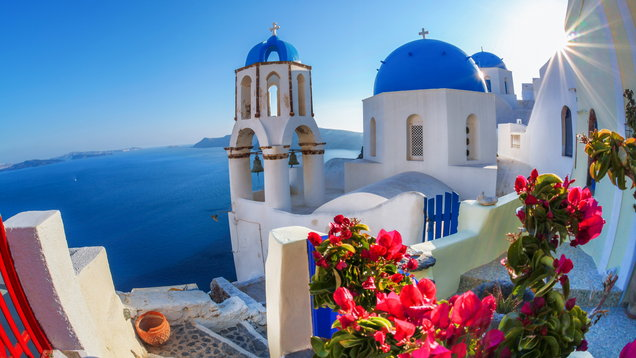 Oia village in Santorini island with famous churches, Greece