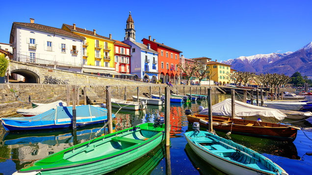 Colorful boats in old town of Ascona, Ticino, Switzerland