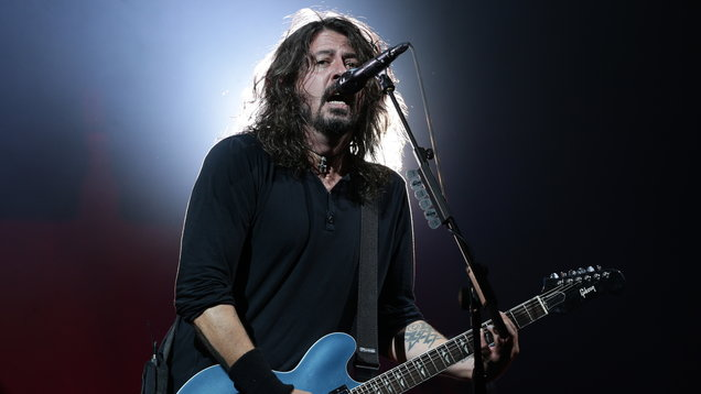 Foo Fighter frontman Dave Grohl, who was spotted with a bottle of Buckfast