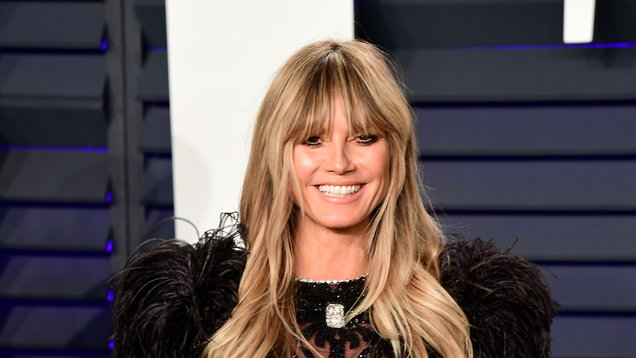 Heidi Klum bares breasts in honeymoon snap