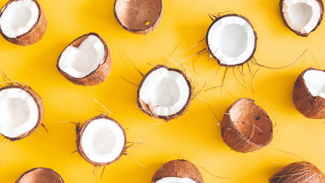 Summer composition. Coconut pattern on yellow background. Summer concept. Flat lay, top view
