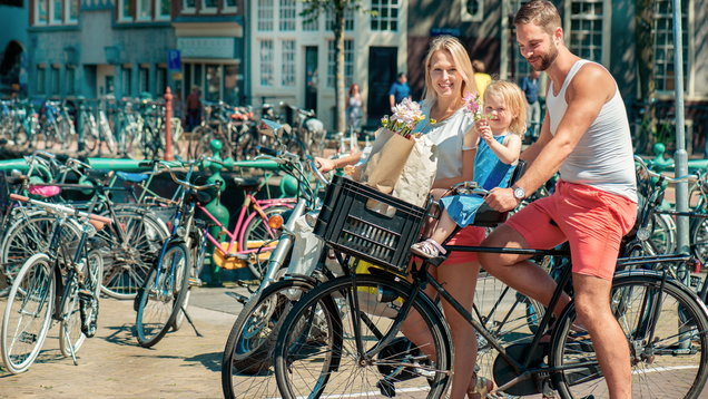 Parents on bikes at the streets of Amsterdam